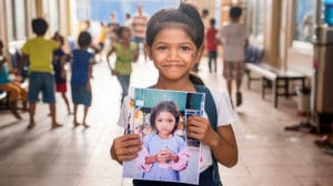 Cambodian Children's Fund student with picture