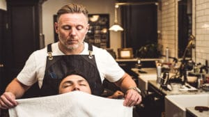 image of barber for story on men's grooming