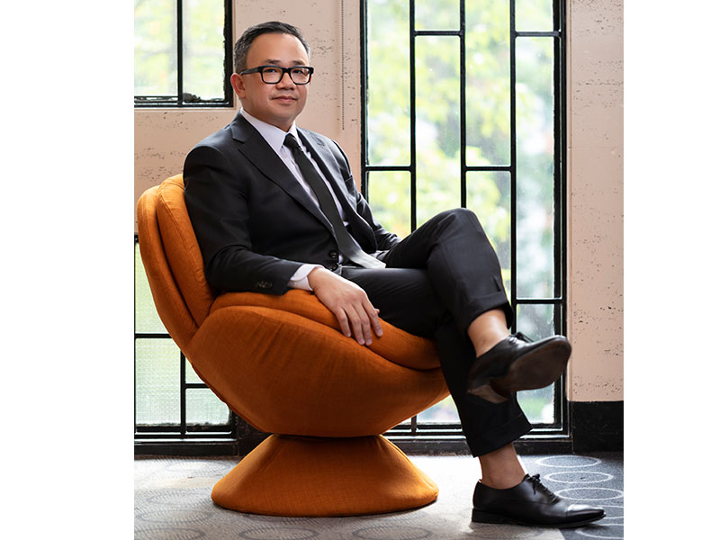 Professor Khoi Vo seated